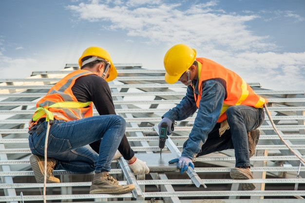 construction-worker-wearing-safety-harness-belt-during-working-installing-concrete-roof-tile-top-new-roof_64073-449-1